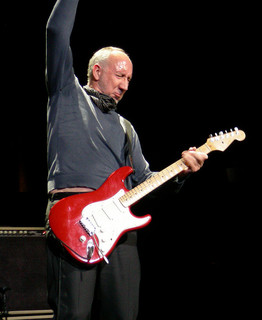 Pete Townshend mid-windmill