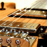 guitar closeup photo by Sam Foles